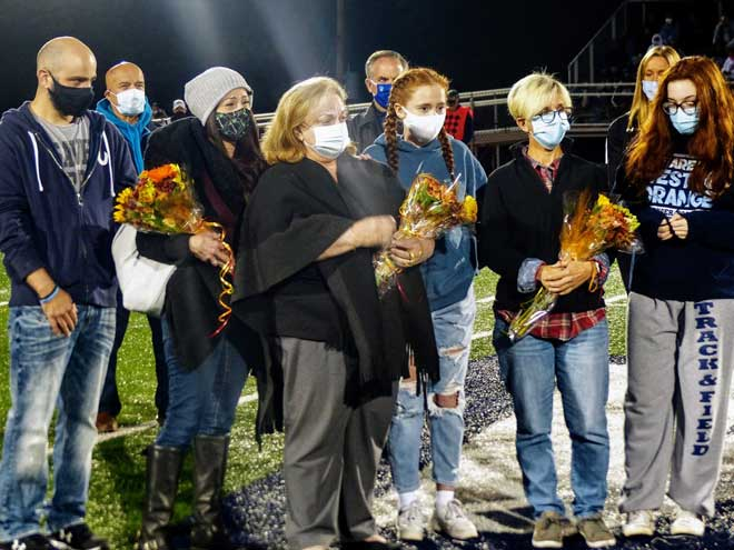 WOHS honors beloved coach during season opener