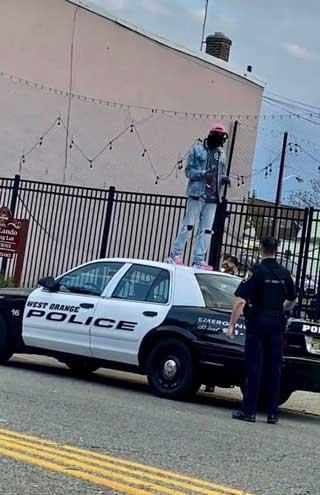 West Orange police arrest man for jumping on squad car