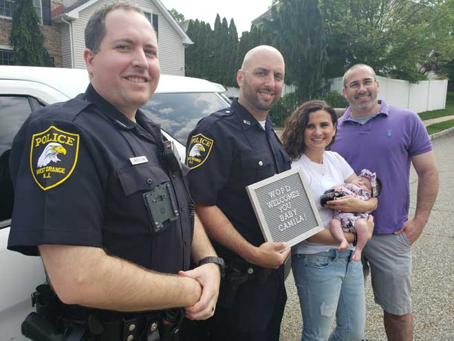 West Orange PD officers visit baby they helped deliver in driveway