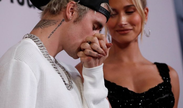 Justin Bieber kisses the hand of his wife, Hailey Baldwin, on the red carpet of their documentary on Youtube, 'Seasons'.