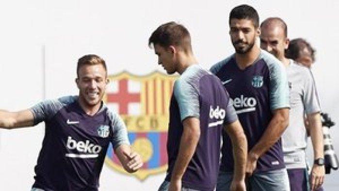 Suárez y Arthur durante un entrenamiento
