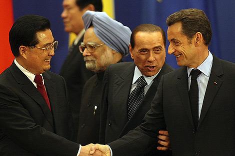 Hu Jintao, Berlusconi y Sarkozy. | Ap