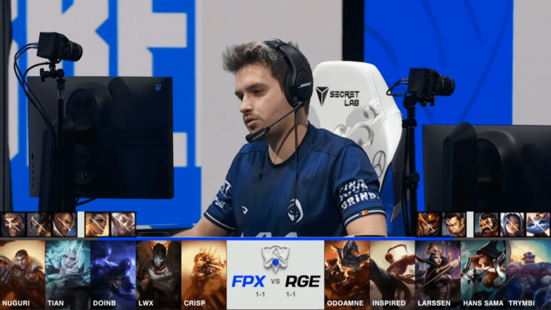 A screenshot from the 2021 World Championship Main Event Group Stage broadcast, showing the champion drafts between FunPlus Phoenix and Rogue with a shot of RGE top laner Odoamne above.