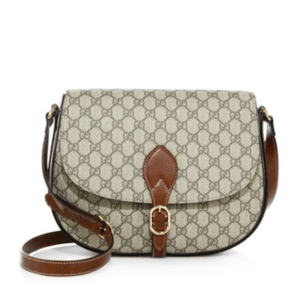 Gucci Supreme Large Saddle Bag, $1,250