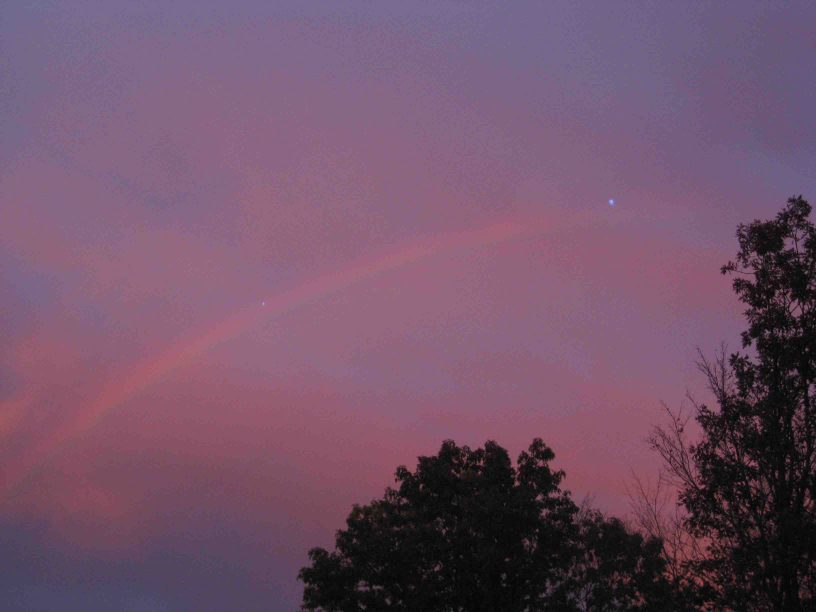 rainbow in pink sunset in New Jersey