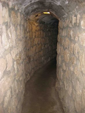 tunnel orginally a dirt crawl space, improved for visitors