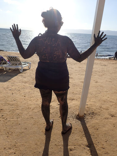 suman covered in mud at the dead sea