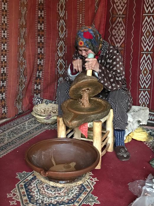 grinding argan nuts into oil