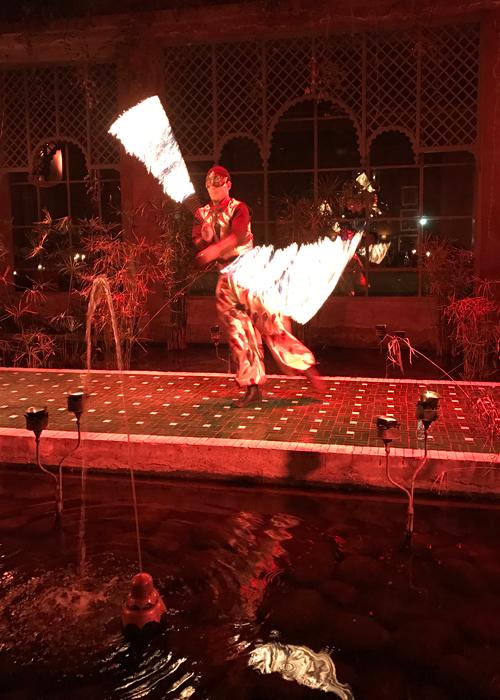fire dancer at at palais jad mahal