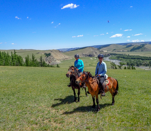 Page and I riding horses on the mongolian steppe