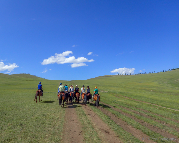 riding on the mongolian steppe