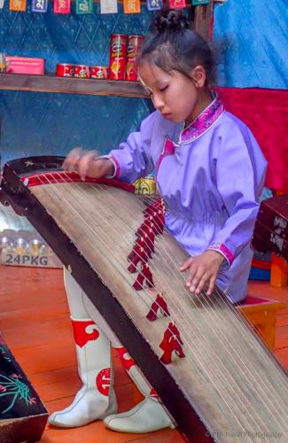 mongolian girl playing music
