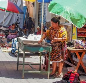 vendor at chichicastenango market