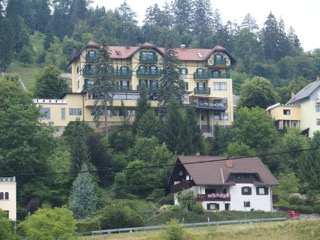 view of hotel above from the lake