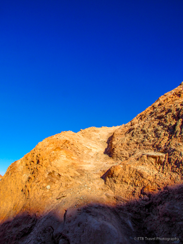 Trail up gray mound to summit