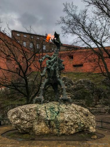 Dragon statue spitting fire