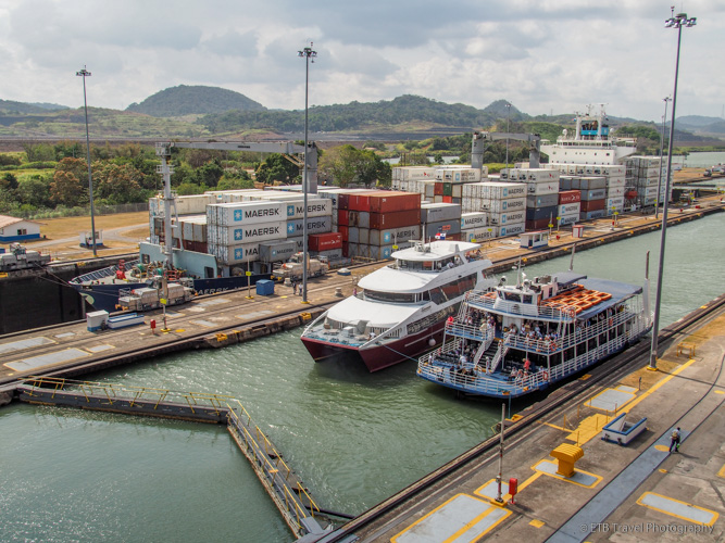 small boats entering miraflores locks in the Panama Canal