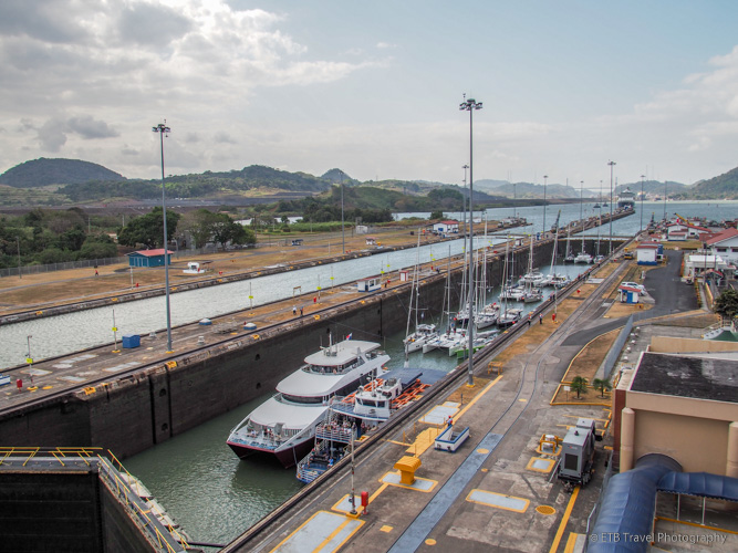 small boats in the miraflores locks on the Panama Canal