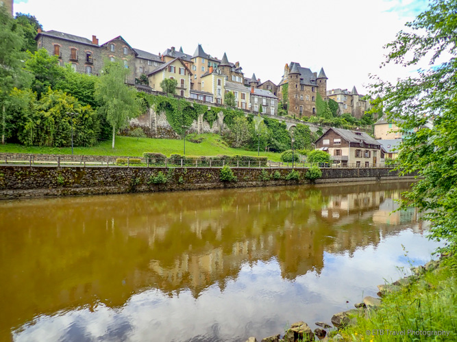 uzerche with reflection in river
