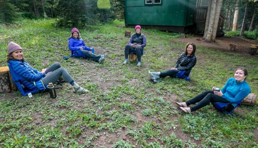 sitting outside Ridgway Hut