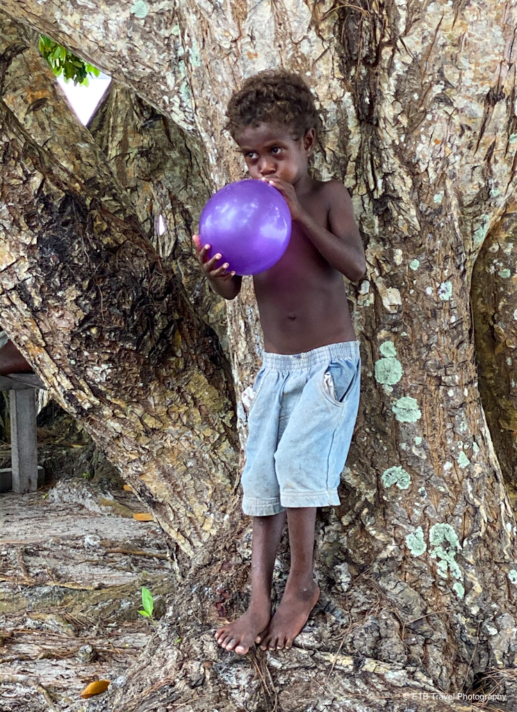 young solomon boy blowing up balloon