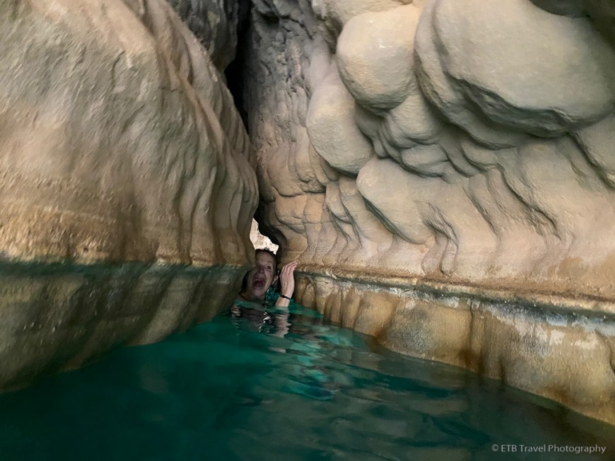 pulling ourselves through the crevice at wadi shab