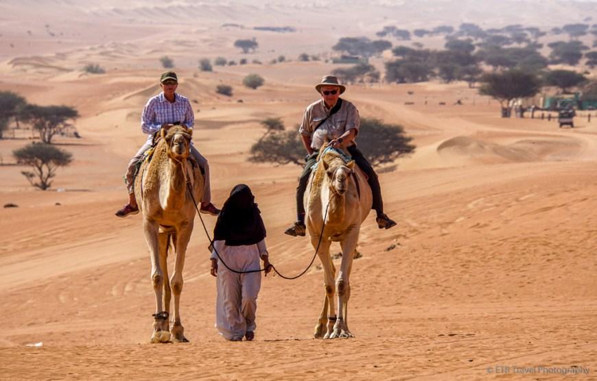 camel riding in sharqiya sands