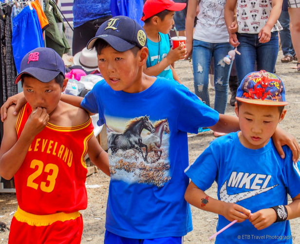 kiddo in knock off Nike shirt at Naadam