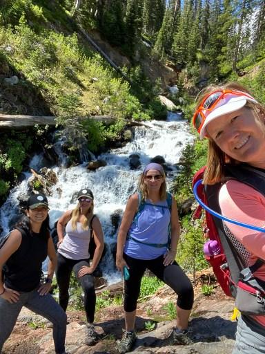 selfie in front of waterfall on Lake Katherine Trail