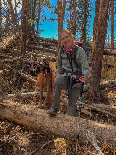 Annie and I climbing over log in Eagles Nest Wilderness