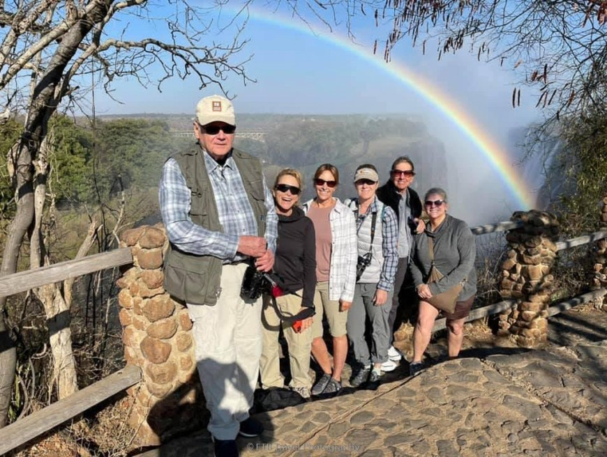 our group with rainbow at victoria falls