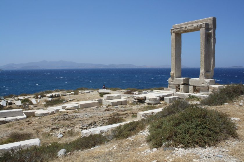 The remains of the foundations, crepidoma and doorway leading from the prodromos to the cella of the 6th century BCE temple of Apollo on Naxos in the Cyclades. The doorway is 6m high and 3.5 m wide. The temple itself, as indicated by its surviving foundations, measured some 59 by 28 metres.