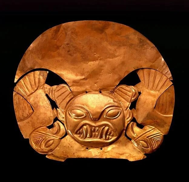 A Moche gold headdress (1-700 CE). The figure represents a fanged deity, a common subject in Moche art. (Larco Museum, Lima)