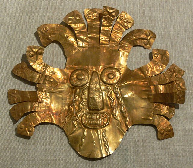 A beaten gold mask from the Nazca civilization of Peru, 200 BCE-500 CE. 18.4 x 20.5 cm. The mask may represent a shaman in transformational pose, a common motif in Nazca art. An alternative interpretation is that it represents the weeping sun deity common to several ancient Andean cultures. (Dallas Museum of Art)