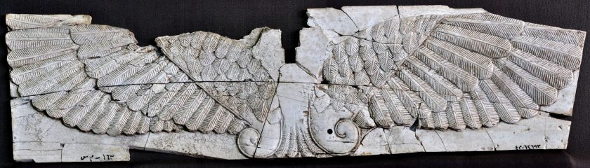 Carved ivory plaque of wings of God Ashur. Neo-Assyrian period, 9th-7th centuries BCE. From Nimrud, Mesopotamia, Iraq. (The Sulaimaniya Museum, Iraq).