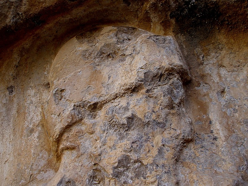 Head of the warrior. Note the bullet marks. The relief was shot intentionally, several times! This photo was taken in 2006, during the restoration work. Photo courtesy, Mr. Akam Omar.