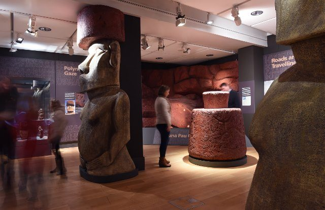 """Main exhibition gallery showing replica pukao and model of the Puna Pau """"hat"""" quarry. Photo: Joe Gardner. (Courtesy of Manchester Museum.)"""