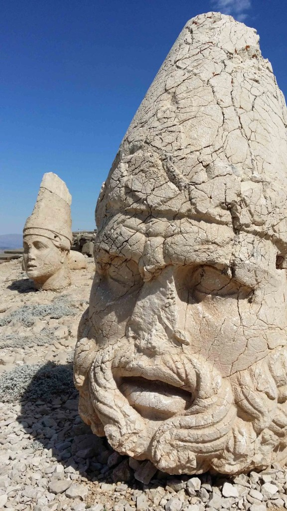 Head of Zeus Ahuramazda with head of Antiochus I behind. Photographer: Alkans Tours, Nicholas Kropacek