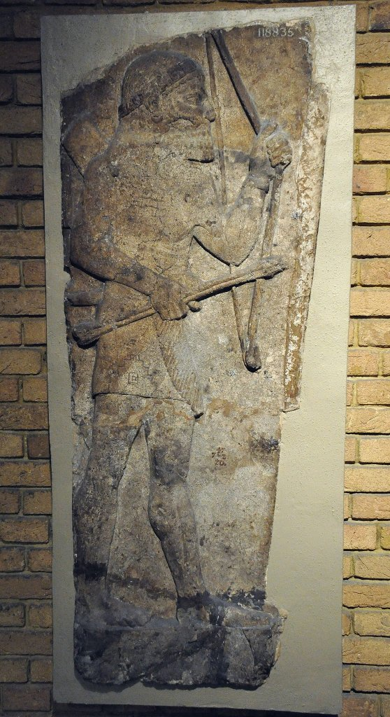 This gypsum relief, which depicts an archer, was part of a larger wall relief that demonstrates the Assyrian army and Sargon II's attack on the city of Amqaruna (Biblical Ekron) in central Palestine, probably in 720 BCE. The archer holds a bow and arrows and wears a loin-cloth with fringe; obviously he is not an Assyrian soldier (an enemy?). From the palace of Sargon II at the city of Khorsabad (ancient Dur-Sharrukin), northern Mesopotamia. Iraq. Neo-Assyrian period, 710-705 BCE. (The British Museum, London). Photo © Osama Shukir Muhammed Amin FRCP (Glasg)