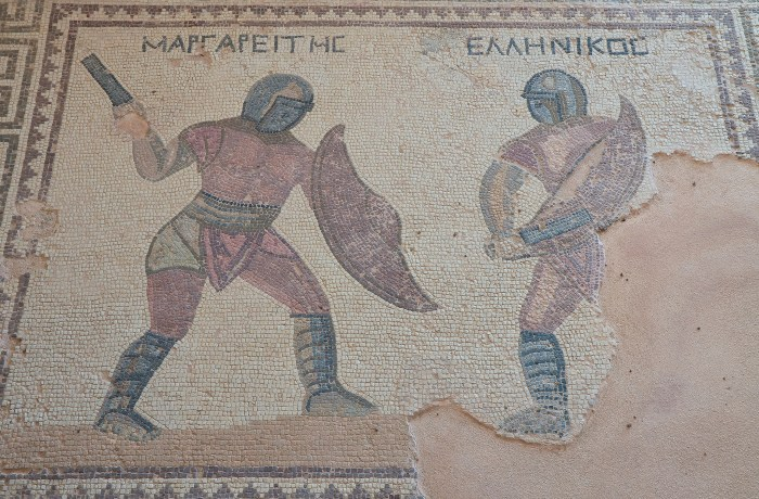 Mosaic depicting two gladiators in combat, their names in Greek listed above: Margarites (left) and Hellenikos (right), late-3rd century AD, House of the Gladiators, Kourion