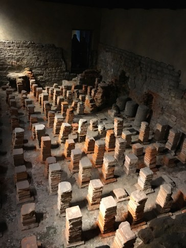 Remnants of the hypocaust at the Roman baths. Image © Caroline Cervera.
