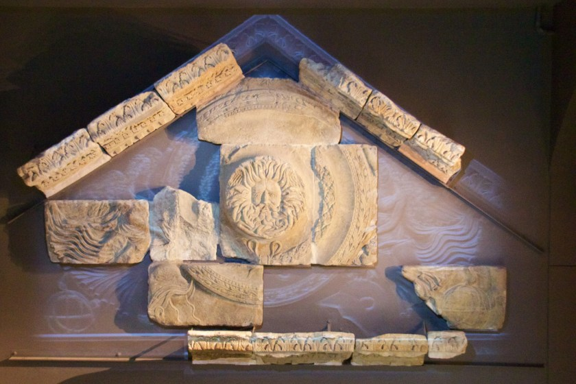 The Gorgon and how it would have fit into the original pediment at the Roman baths. Image © Nick Peel.