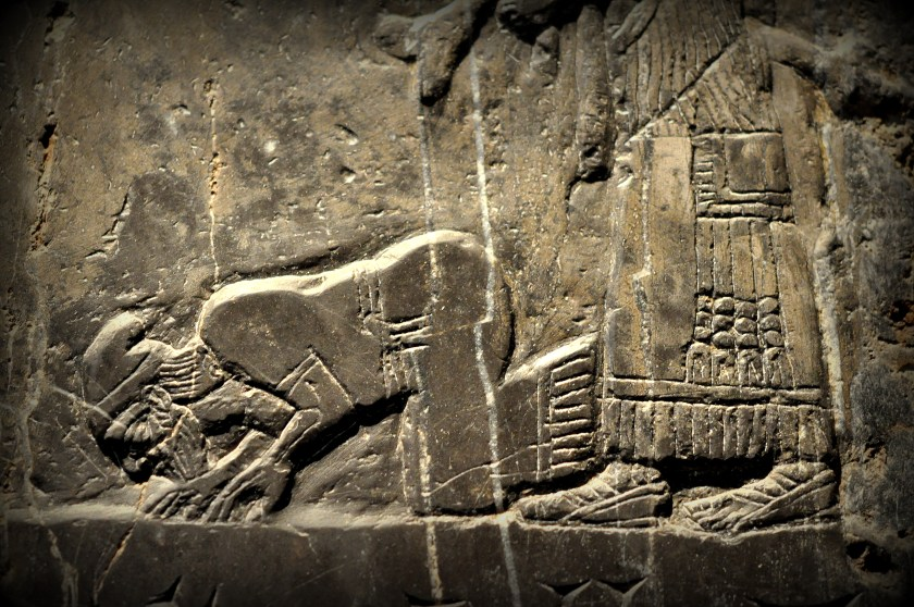 Jehu (son of Omri), king of Israel, bows and prostrates before the Assyrian king Shalmaneser III (not shown). An Assyrian attendant stands behind Jehu. Jehu is thought to be a Biblical figure. Detail of the Black Obelisk, Side A, register 2. Photo © Osama S. M. Amin. Black Obelisk of Shalmaneser III.