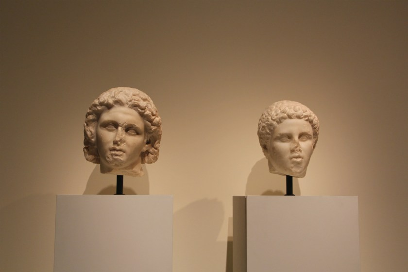 Alexander and a young man, likely Hephaistion, side by side at the exhibition. Image © Caroline Cervera. Hellenistic portraiture.