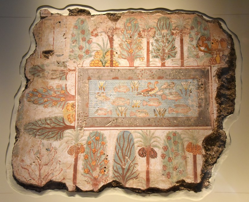 Nebamun's garden in the afterlife is like the erathly gardens of the wealthy in ancient Egypt. The pool is full of birds and fish, surrounded by borders of flowers and rows of trees. The fruit trees include sycomore-figs, date-palms, and dom-palms; the dates are shown in different stages of ripeness. On the right of the painting, the goddess Nut, leans out of a tree, and offers sycomore-figs to Nebamun (now lost). On the left of the pool, a sycomore-fig tree speeks and greets Nebamun as te owner of the garden; her words are recorded in hieroglyphs. Photo © Osama S. M. Amin.