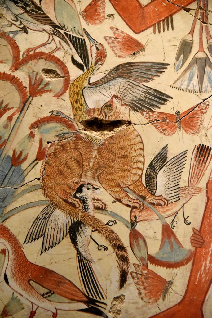 A tawny cat catches birds in among the papyrus stems. Cats were family pets, but he is shown here because a cat could also represent the Sun-god hunting the enemies of the light and order. His unusual gildeed eye hints at the religious meanings of this scene. The British Museum, London. Photo © Osama S. M. Amin.