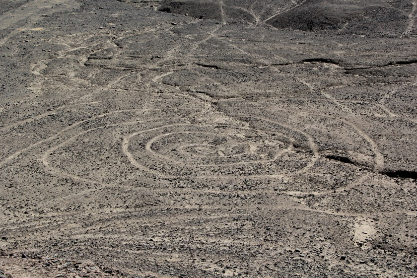 The spiral begins in at a central point and infinitelywinds outwards into eternity. Image © Caroline Cervera. Nazca lines