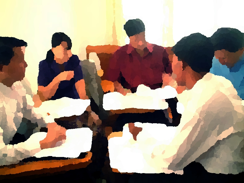 a group of people discussing; picture artistically blurred