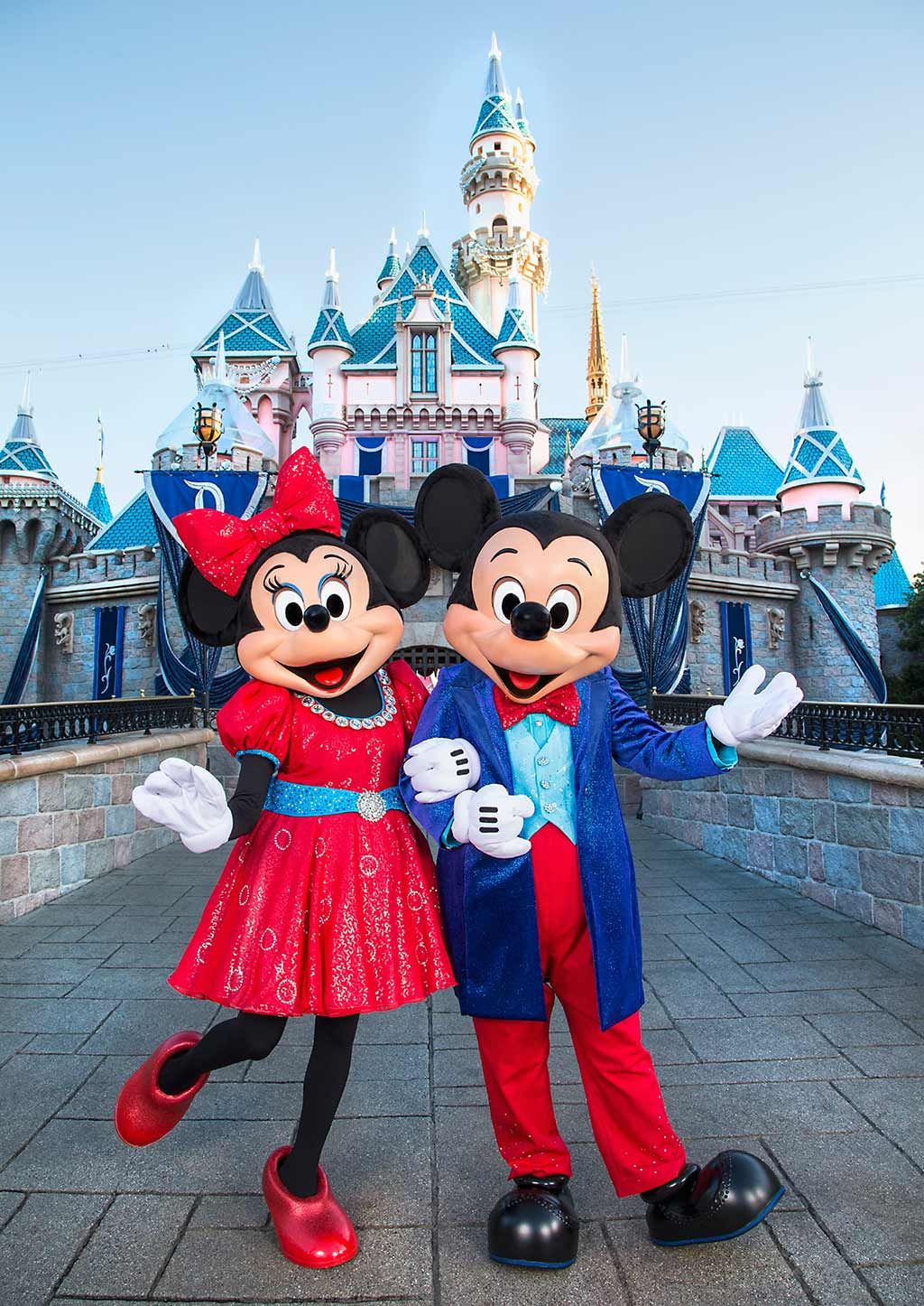Mickey Mouse and Minnie Mouse in front of the castle