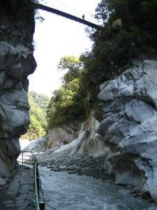 At the bottom of the Taroko Gorge in Wenshan, with a suspension bridge above